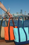 canvas bags: beige, orange, light blue